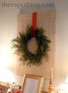 """At Christmas time, wrap """"everyday"""" artwork with burlap and hang a wreath on it."""