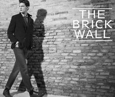 with the brick wall...clothes would be more casual