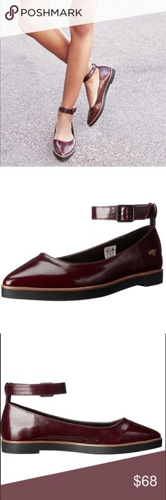 Burgundy Boxed In Mary Jane Loafer Flats These Rocket Dog flats offer a classic look with a modern twist on the outsole. Polyurethane leather upper. Ankle strap with buckle closure. Pointed toe. Man-made lining. Lightly-padded insole. Heel Height: 3⁄4 in Rocket Dog Shoes Flats & Loafers