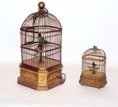 Singing Automaton Birds in Gilded Cages