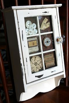 thrift store cabinet turned vintage sewing notion display