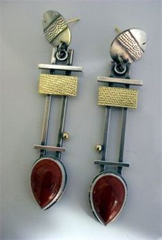Michele LeVett.......Connie Fox: The horizontal line repeated unifies these earrings.