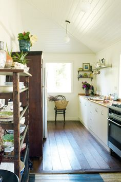 The kitchen's hoop pine floorboards survived the move from Queensland.   For more Country Style kitchen ideas...