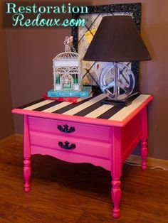 Restoration Redoux.. night stand redo. The bottom painted with hot pink DIY chalkpaint, while the top is painted white with black painted taped off stripes. Coat with a clear wax.
