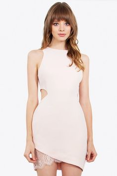 Sugar Lips Romantic Dress in Peach with side cut outs and lace insert detail. Perfect summer dress in light peach.