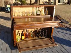 Have an old piano?  Here's a new use for it.  A drink anyone?