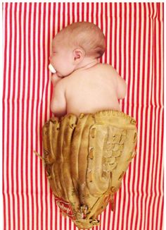 Newborn Eric and I met at a softball game, so it seemed fitting to take a picture of Britain with Eric's glove.