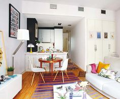 I found this Madrid apartment via Pinterest , and was immediately drawn to the little round table (pic 3) surrounded by Eames chairs - I ha...