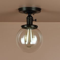 Semi Flush Light w/ 6 inch Clear Glass Globe Oil Rubbed