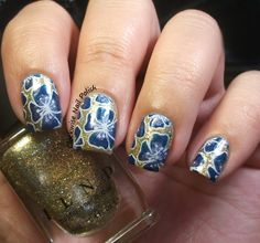 The Clockwise Nail Polish: ILNP Empire & NCLA Spaced Out with UberChic Beauty Nail Art Designs. Look at this lovely Blue and Gold floral design! Nail stamping allows you to create your own look at be creative. UberChic Nail Art Rocks!