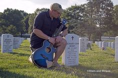 Staff Sgt. Nathan Fair pauses by the gravemarker of a fallen friend and fellow soldier at Arlington National Cemetery in late August 2014. (Meredith Tibbetts/Stars and Stripes)