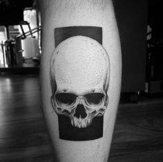Negative space skull tattoo by Matt Pettis