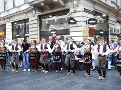 Folk dancers performing on the street