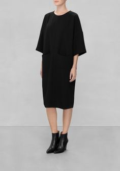 Wide sleeves, oversized patch pockets and a chunky zip define this clean-cut dress made from a drapey fabric.
