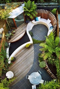 Great use of a small space. Love the mix of materials and the decking over the water feature. Blissful!