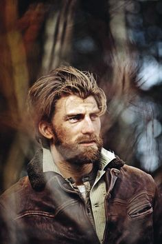 Nothing wrong with a little rough and rugged leather. This whole picture...the hair, the beard, the clothes..wow!