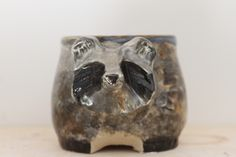 Raccoon mug by Catie Daniel