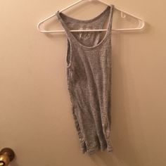 Gray tank top Medium but fits like a small One step up Tops Tank Tops