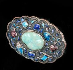 Nice early 20th c. Chinese export silver-gilt copper and enamel brooch featuring a pretty polished turquoise cab.