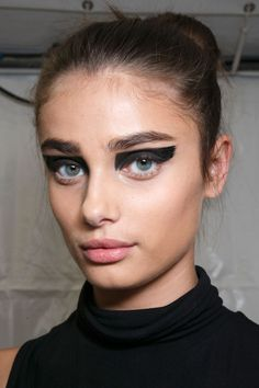 Tom Pecheux emphasized eyes with black pigment, leaving lashes and lips bare. To get the look, try M.A.C Fluidline in Blacktrack.   - ELLE.com