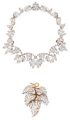 18 KARAT TWO-COLOR GOLD AND DIAMOND BROOCH AND NECKLACE, SCHLUMBERGER FOR TIFFANY & CO., FRANCE. Of foliate design, set with round diamonds, signed Tiffany Schlumberger; necklace designed as a graduated meandering vine set with numerous round diamonds accented by baguette diamonds signed Tiffany Schlumberger, with French assay and workshop marks. With signed and fitted box.