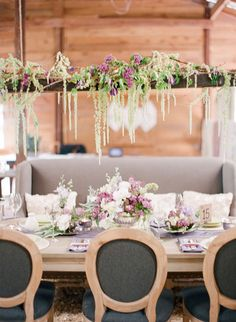 Suspended beams with hanging amaranthus and other lovely blooms and vines.