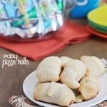 Simple & delicious Pizza Rolls made from ready-made pizza dough, mozzarella sticks, pizza sauce and pepperoni all rolled together in a fun l...