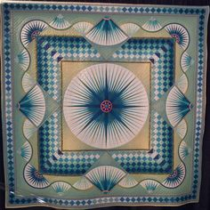 """""""Departure"""" by Kiyomi Takayanagi, Mariner's Compass star quilt. Spotted at Houston Quilt Market Day 2 2012.  Posted at The Cotton Patch Blog (UK)"""