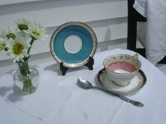 Mismatched set of Aynsley china teacup and two saucers for vintage and victorian