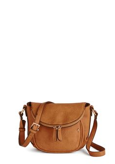 First Things Verse Bag. When inspiration strikes, you immediately grab a pen from the front pocket of this caramel purse. #tan #modcloth