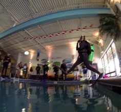 Scuba Instructor shows the class a Giant Stride into our indoor, heated pool!