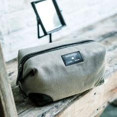 Made from handcrafted supple black leather and canvas this stylish wash bag makes a perfect gift for the avid traveller. #giftsforhim #buorx #buorxboxes Men's Society
