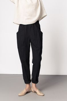Clyde Work Pant by Elizabeth Suzann. Black slouchy pants with elasticated waist, deep pockets and seam detail. (Made in US)