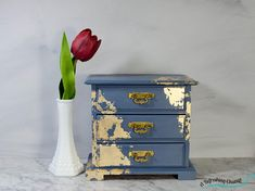 A hand painted vintage jewelry box.  A musical jewelry box in moody blue detailed with gold leaf for an elegant style & a one of a kind gift