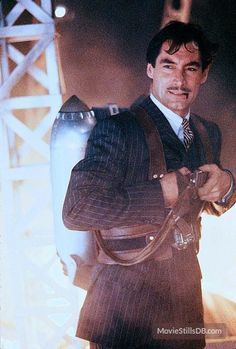 Neville Sinclair -- ruthless Nazi agent sent by Germany to steal the Rocketeer jetpack developed by Howard Hughes. Super Hero Outfits, Super Hero Costumes, Joe Johnston, Walt Disney Movies, Timothy Dalton, Howard Hughes, Best Comic Books, Roger Moore, Charming Man
