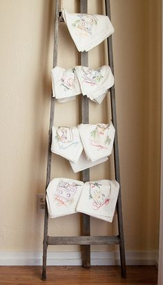 Special tea towels displayed on a wooden ladder. Wooden Ladder, Ladder Decor, Towel Display, Shop Around, Around The Corner, Ladder Bookcase, Hang Tags, Tea Towels, Sewing Ideas