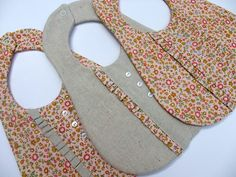 Super cute baby bibs - someone needs to have a girl so I can make some of these!