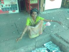 https://flic.kr/p/skPzJ6   She Is a Christian Lady Who Begs At Bandra Reclamation   I shot her video this morning her mother was a singer , she is a singer too, she feeds cats and dogs , and has been begging for a few years now , she does not drink she told me , she wanted me to buy her a cup of tea I did ,, but I did spot her counting a bunch of Rs 100 notes , but she told me that it belonged to someone else ..  I shoot her in the mornings but it was the first time I spoke to her she sang a song for me ,,