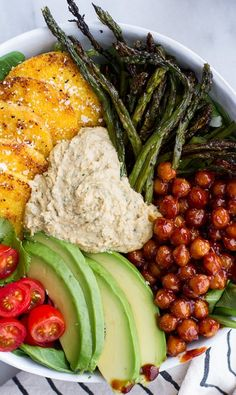 The recipe is kind of obvious. Pinning it to remember to make it sometime. BBQ Chickpea and Crispy Polenta Bowls with Asparagus + Ranch Hummus