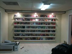 "Homemade comic display shelves made out of rain gutters by ""harkiamsuperman"""
