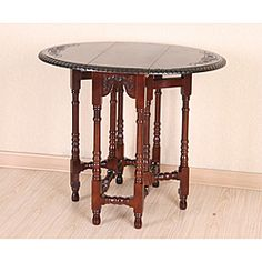 @Overstock - This elegant accent table features a scroll design hand-carved into mahogany stained hardwood. With gate legs that fold in and out to lower or raise the drop-leafs on either side, this table features unique and strong construction.  http://www.overstock.com/Home-Garden/Hand-Carved-Mahogany-Drop-Leaf-Oval-Table/6437541/product.html?CID=214117 $215.99