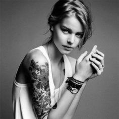 black and white beautiful female arm sleeve tattoo