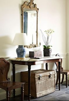 Luv the wicker trunk and two side chairs...charming