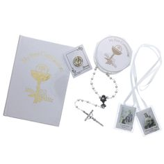 Perfect for any young Catholic girl on her First Holy Communion, this traditional style gift set includes My First Communion Book, a rosary and rosary box, a sparkly chalice and host pin, and a white scapular.