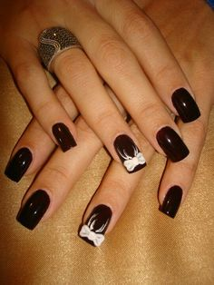 Dark nails with bows... cute!