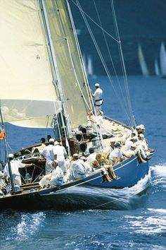 Blue sail boat w/ large crew - Sailing - Seatech Marine Products & Daily Watermakers