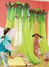 Playtime becomes an enchanting adventure when children gather inside this magical canopy crowned with a bountiful garland of flowers and ribbons. Indoors, drape it over a twin-size bed to create a canopy that's sure to bring beautiful dreams. The gauzy green hideaway is easy to set up and take down, and spacious enough inside for several children to play together. Nylon tie-backs create a door opening for easy access.