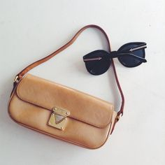 {Louis Vuitton} Vernis Malibu Street Pochette 100% Authentic verified.  Champagne colored Vernis patent leather with vachetta leather and gold hardware.  Light mark on the back, unnoticeable when worn.  Date code pictured.  Made in France. Louis Vuitton Bags Mini Bags