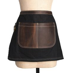 """From the Birdkage Utility collection, inspired by rugged American tradition. The """"Peyton"""" style is made of waxed heavyweight cotton canvas with a distinct """"grid"""" pattern, and trimmed with heavy-duty saddle leather. Our half style apron is the ideal potting shed apron, perfect for the gardener in all of us. Available in four colors: Jet Black […]"""