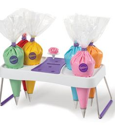 This Wilton Piping Bag Holder features metal legs and a convenient plastic stand. Feel like a professional cake decorator with this Wilton Piping Bag Holder! Wilton Cake Decorating, Cake Decorating Supplies, Cake Decorating Techniques, Cookie Decorating, Cake Decorating Equipment, Decorating Tips, Wilton Cakes, Cupcake Cakes, Birthday Cakes